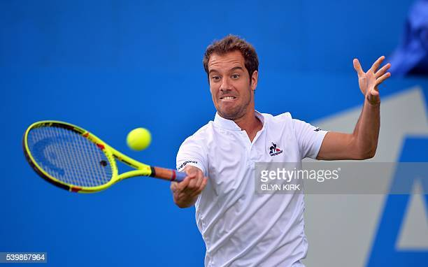 France's Richard Gasquet hits a return during his men's singles match against US player Steve Johnson at the ATP tournament at Queen's tennis club,...