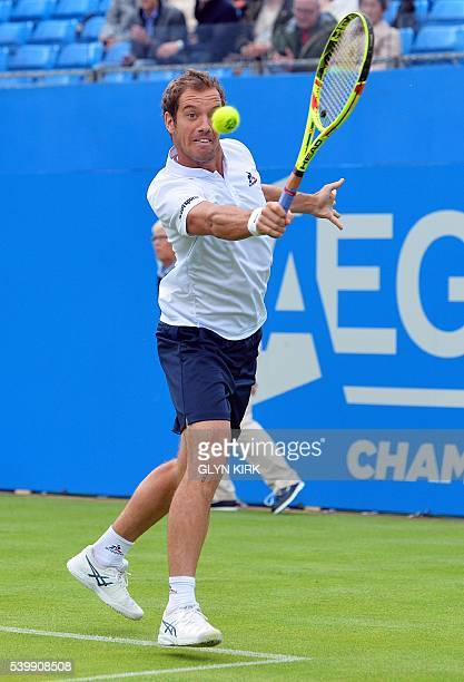 France's Richard Gasquet plays a backhand during his men's singles match against US player Steve Johnson at the ATP tournament at Queen's tennis...