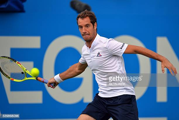 France's Richard Gasquet plays a forehand during his men's singles match against US player Steve Johnson at the ATP tournament at Queen's tennis...