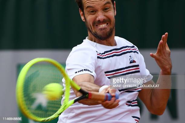 France's Richard Gasquet plays a forehand return to Argentina's Juan Ignacio Londero during their men's singles second round match on day four of The...