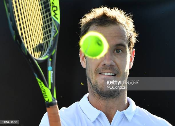 TOPSHOT France's Richard Gasquet plays a forehand return to Slovenia's Blaz Kavcic during their men's singles first round match on day two of the...