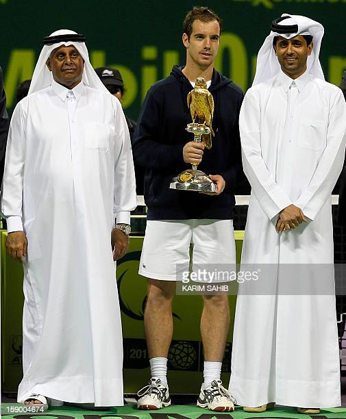 France's Richard Gasquet poses with the head of the Qatar Tennis Federation Nasser AlKhelaifi and Qatar's Deputy Prime Minister Abdullah bin Hamad...