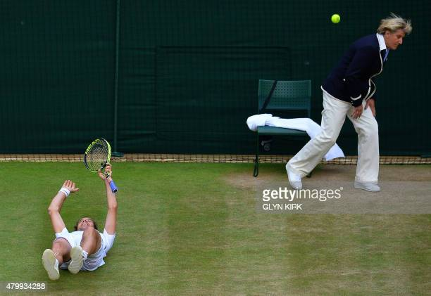 France's Richard Gasquet reacts after beating Switzerland's Stan Wawrinka while the line judge ducks away from the ball in their men's quarterfinal...