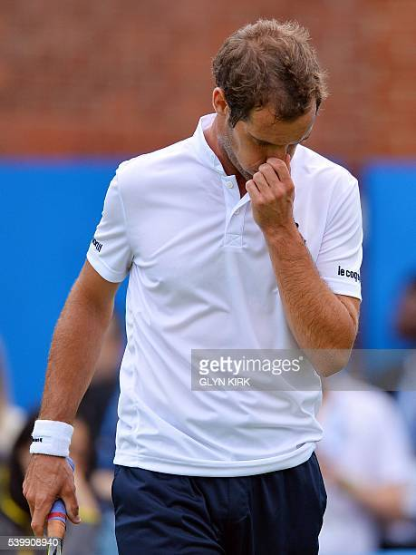 France's Richard Gasquet reacts after losing the first set in his men's singles match against US player Steve Johnson at the ATP tournament at...