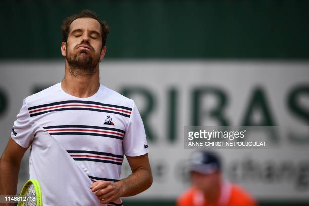 France's Richard Gasquet reacts as he plays against Argentina's Juan Ignacio Londero during their men's singles second round match on day four of The...
