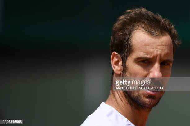 TOPSHOT France's Richard Gasquet reacts as he plays against Argentina's Juan Ignacio Londero during their men's singles second round match on day...