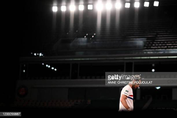 France's Richard Gasquet reacts as he plays against Spain's Rafael Nadal during their men's singles second round tennis match on Day 5 of The Roland...