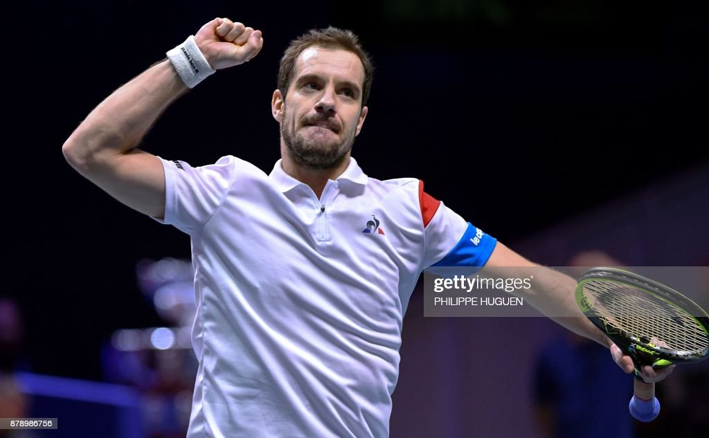 France's Richard Gasquet reacts during the doubles tennis match at the Davis Cup World Group final between France and Belgium at Pierre Mauroy Stadium in Lille on November 25, 2017. /