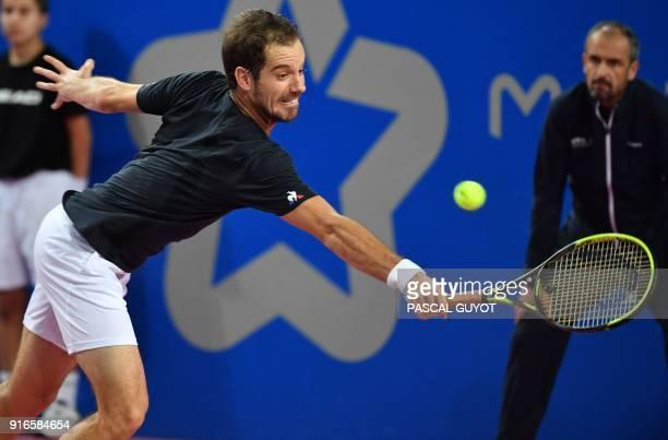 France's Richard Gasquet returns the ball to Belgium's David Goffin during their ATP World Tour Open Sud de France semi final tennis match in...