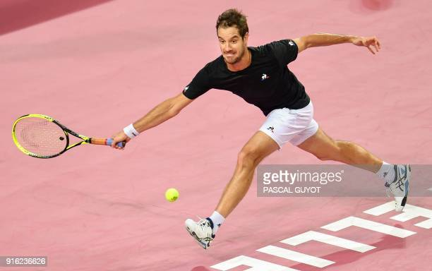 TOPSHOT France's Richard Gasquet returns the ball to Bosnia's Damir Dzumhur during their quarterfinal singles tennis match at the Open Sud de France...