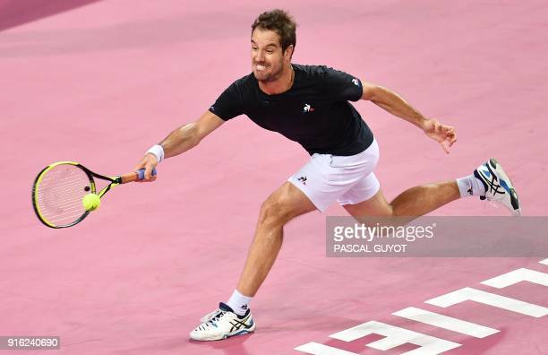 France's Richard Gasquet returns the ball to Bosnia's Damir Dzumhur during their quarterfinal singles tennis match at the Open Sud de France ATP...