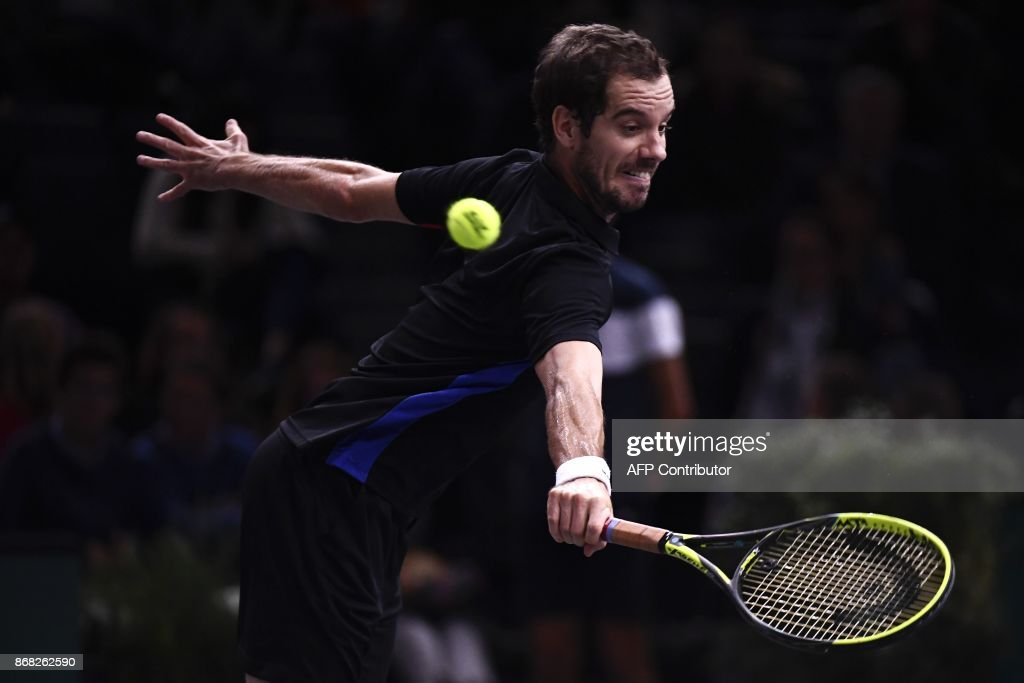 France's Richard Gasquet returns the ball to France's Benoit Paire during the first round at the Paris Masters ATP tennis Open on October 30, 2017 in Paris. /