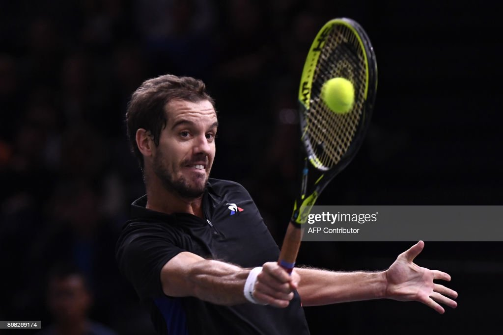 TOPSHOT - France's Richard Gasquet returns the ball to France's Benoit Paire during the first round at the Paris Masters ATP tennis Open on October 30, 2017 in Paris. /