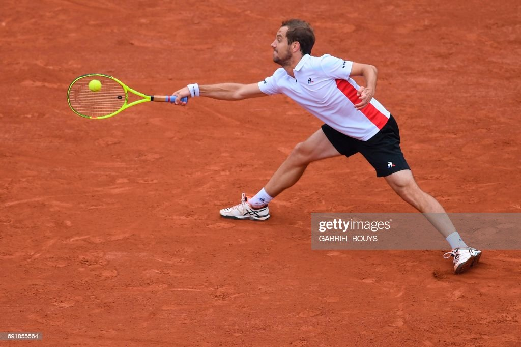 France's Richard Gasquet returns the ball to France's Gael Monfils during their tennis match at the Roland Garros 2017 French Open on June 3, 2017 in Paris. /