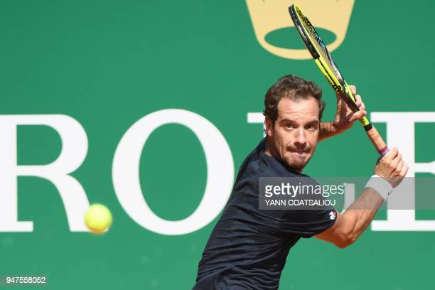 France's Richard Gasquet returns the ball to France's Jeremy Chardy during their tennis match at the MonteCarlo ATP Masters Series Tournament on...