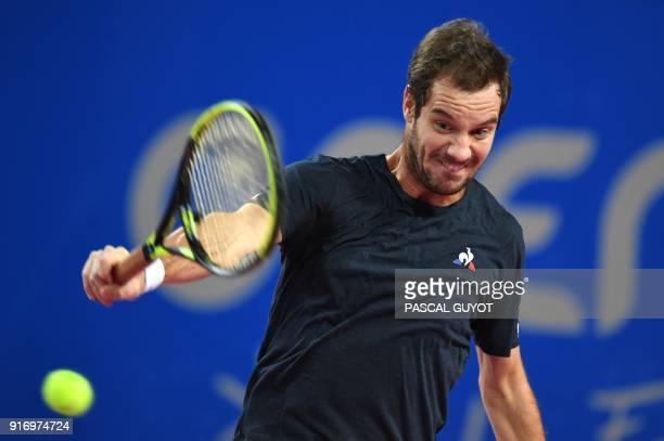 France's Richard Gasquet returns the ball to France's Lucas Pouille during the final of the ATP World Tour Open Sud de France in Montpellier southern...