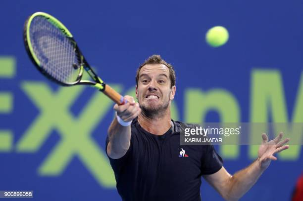 TOPSHOT France's Richard Gasquet returns the ball to Greece's Stefanos Tsitsipas during the round of 16 in the ATP Qatar Open tennis competition in...