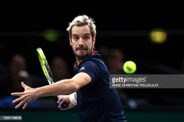France's Richard Gasquet returns the ball to Jack Sock of the US during their men's singles second round tennis match on day three of the ATP World...