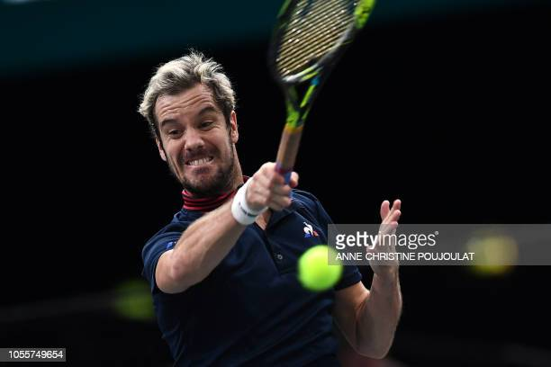 TOPSHOT France's Richard Gasquet returns the ball to Jack Sock of the US during their men's singles second round tennis match on day three of the ATP...