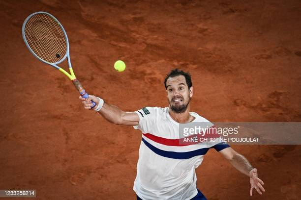 France's Richard Gasquet returns the ball to Spain's Rafael Nadal during their men's singles second round tennis match on Day 5 of The Roland Garros...
