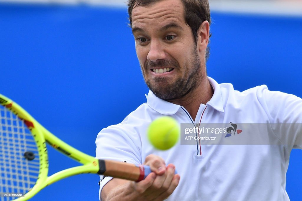 France's Richard Gasquet returns to France's Gael Monfils during their men's semi-final tennis match at the ATP Aegon International tennis tournament in Eastbourne, southern England, on June 30, 2017. / AFP PHOTO / Glyn KIRK