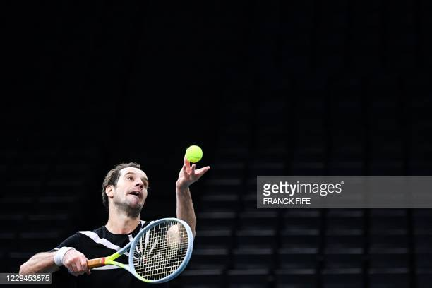 France's Richard Gasquet serves the ball to Argentina's Diego Schwartzman during their men's singles second round tennis match on day 3 at the ATP...