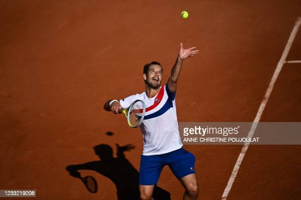 France's Richard Gasquet serves the ball to France's Hugo Gaston during their men's singles first round tennis match on Day 3 of The Roland Garros...