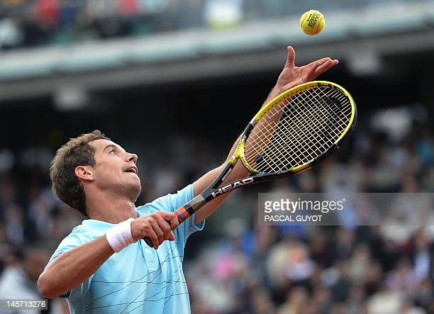 France's Richard Gasquet serves to Britain's Andy Murray during their Men's Singles 4th Round tennis match of the French Open tennis tournament at...