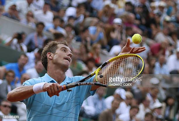France's Richard Gasquet serves to Bulgaria's Grigor Dimitrov during their men's Singles 2nd Round tennis match of the French Open tennis tournament...