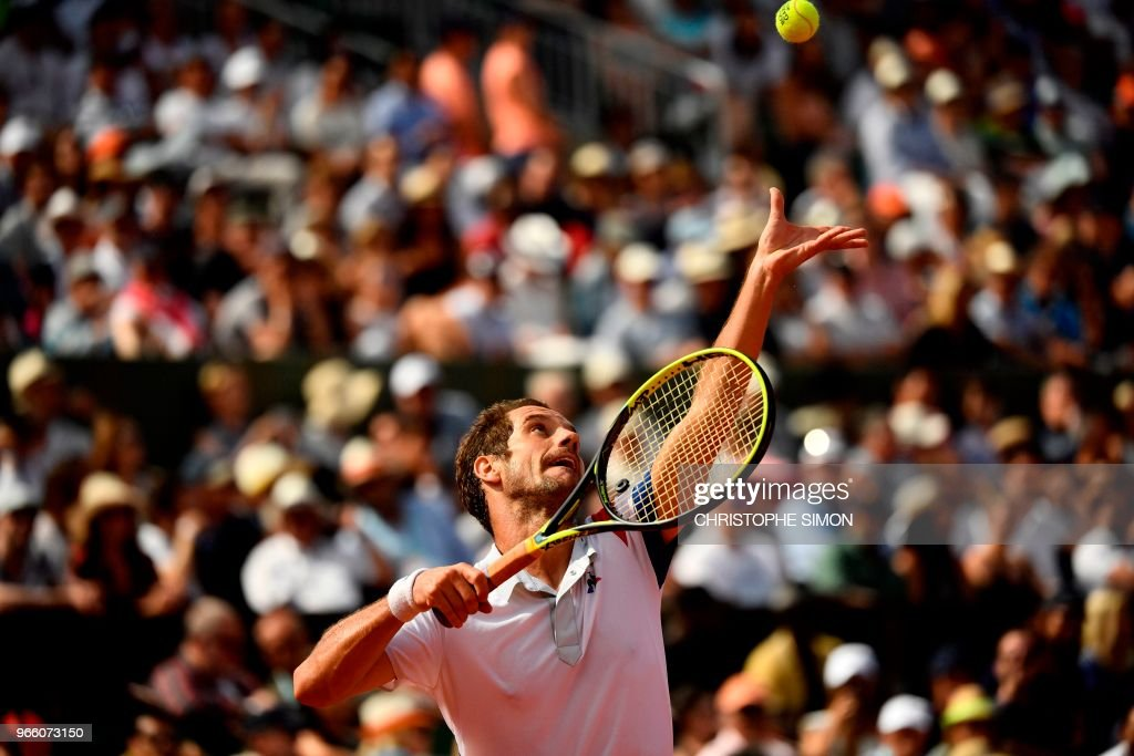 France's Richard Gasquet serves to Spain's Rafael Nadal during their men's singles third round match on day seven of The Roland Garros 2018 French Open tennis tournament in Paris on June 2, 2018.