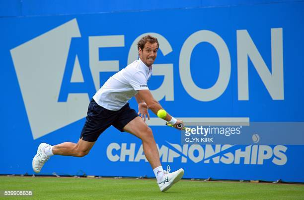 France's Richard Gasquet stretches to play a backhand during his men's singles match against US player Steve Johnson at the ATP tournament at Queen's...