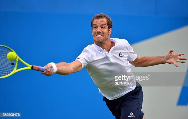 France's Richard Gasquet stretches to play a forehand during his men's singles match against US player Steve Johnson at the ATP tournament at Queen's...