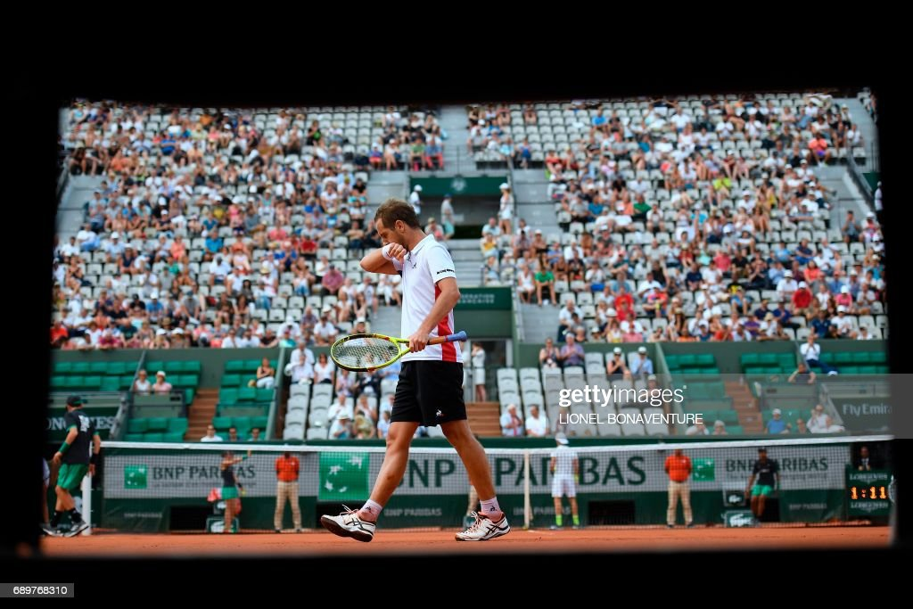 France's Richard Gasquet walks on the court as he plays against Belgium's Arthur De Greef during their tennis match at the Roland Garros 2017 French Open on May 29, 2017 in Paris. / AFP PHOTO / Lionel BONAVENTURE