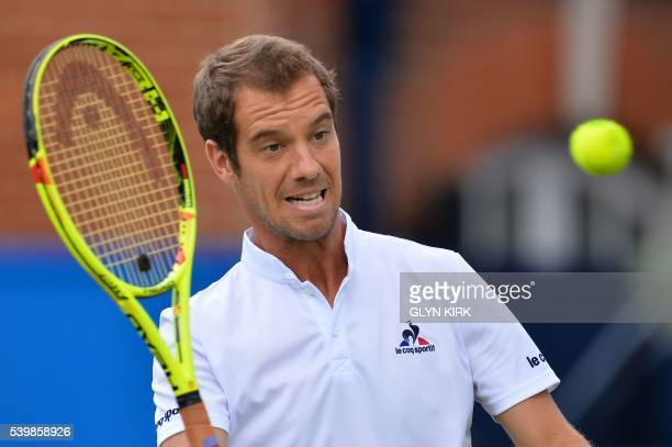 France's Richard Gasquet warms up before his men's singles match against US player Steve Johnson ahead of their men's singles match at the ATP...