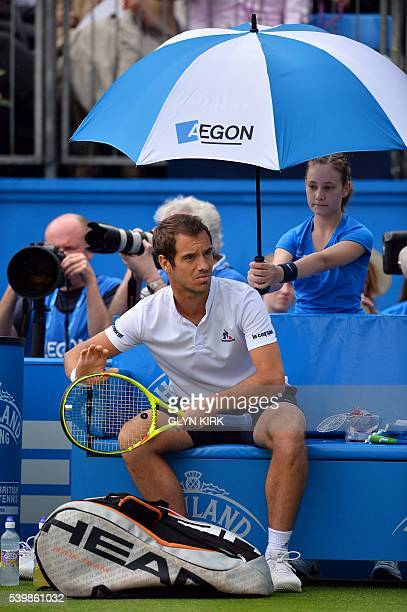 France's Richard Gasquet watches as the rain delays the start of his men's singles match against US player Steve Johnson at the ATP tournament at...
