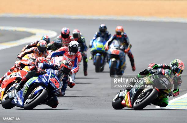 France's rider Johann Zarco on his Monster Yamaha TECH 3 MOTOGP N°5 leads the race at the first corner ahead of Spain's rider Maverick Vinales on his...
