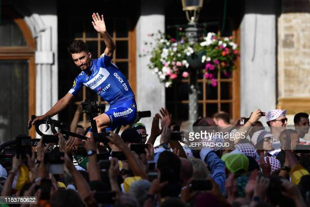 France's rider Julian Alaphilippe of Belgium's Deceuninck-Quick-Step waves as he arrives for the team presentation ceremony at the Grand-Place -...