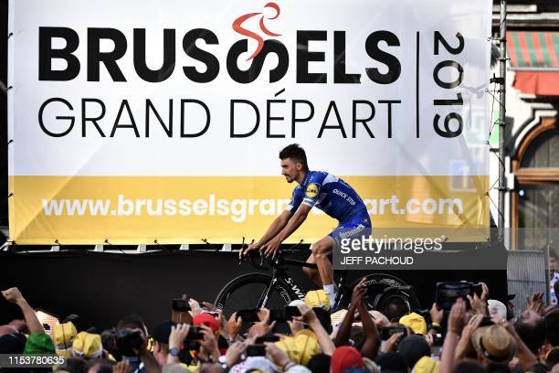 France's rider Julian Alaphilippe of Belgium's DeceuninckQuickStep arrives for the team presentation ceremony at the GrandPlace Grote Markt Square in...