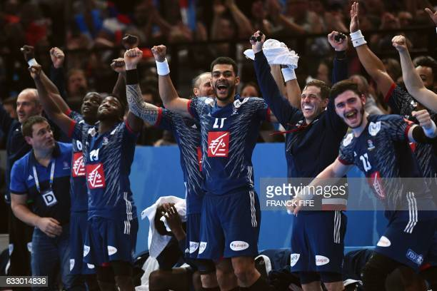 TOPSHOT France's right back Adrien Dipanda France's pivot Ludovic Fabregas and teammates react seconds before winning the 25th IHF Men's World...