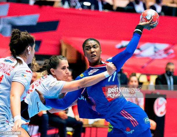 France's Right back Aissatou Kouyate vies for the ball during the main round match between France and Spain of the 2020 EHF European Women's Handball...