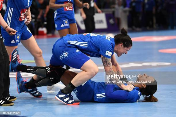 France's right back Alexandra Lacrabere and France's centre back Allison Pineau celebrate after winning the EHF EURO 2018 European Women's Handball...