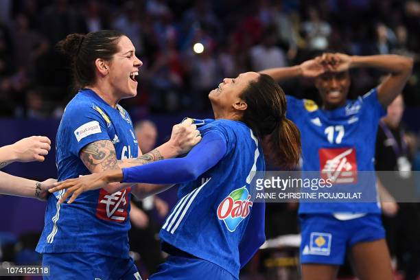 France's right back Alexandra Lacrabere celebrates with France's centre back Allison Pineau after winning the EHF EURO 2018 European Women's Handball...