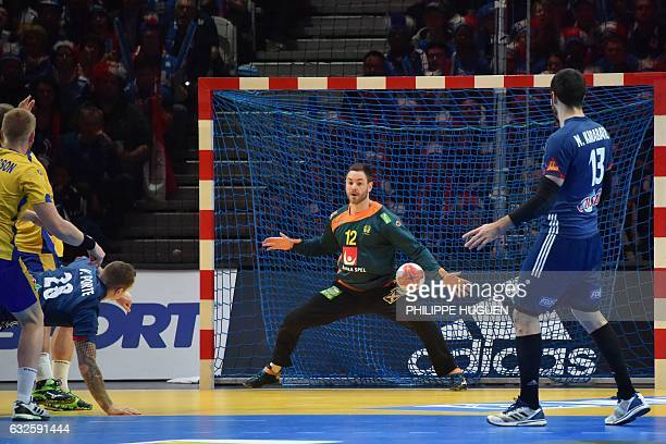 France's right back Valentin Porte scores a goal to Sweden's goalkeeper Andreas Palicka during the 25th IHF Men's World Championship 2017 quarter...