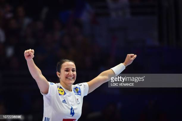 France's right wing Pauline Coatanea celebrates a goal during the Women Euro 2018 handball Championships Group 1 main round match between Serbia and...