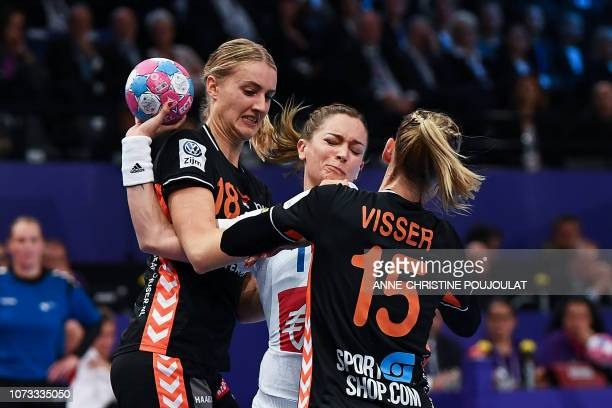 France's right wing Pauline Coatanea vies for the ball with Netherlands' centre back Maura Visser and Netherlands' left back Kelly Dulfer during the...