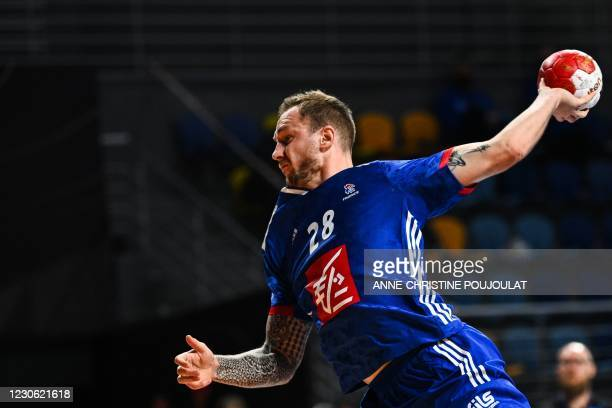 France's right winger Valentin Porte jumps to attempt to score during the 2021 World Men's Handball Championship match between Group E teams Austria...