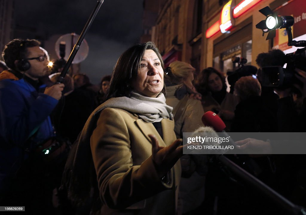 France's right-wing UMP opposition militants talk to the press as they stage a protest outside the party headquarters on November 22, 2012 demanding that their party heads 'enter into conclave', cease making press declarations and talk to each other in a bid to find a solution to the governance of the party. UMP was in disarray today as top officials wrangled over the results of a leadership vote that the party admitted may have been flawed. The UMP's top electoral committee said that the results would 'in all likelihood' be different if all the votes were taken into account and asked the party's appeals body to take a decision.