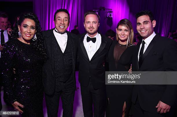 Frances Robinson recording artist Smokey Robinson actor Aaron Paul Lauren Parsekian and manager Eric Podwall attend the 23rd Annual Elton John AIDS...