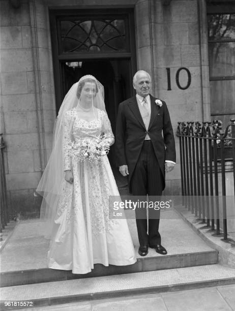 Frances Roche leaves her home in Wilton Crescent London with her father Lord Fermoy for her wedding to John Spencer Viscount Althorp later the 8th...