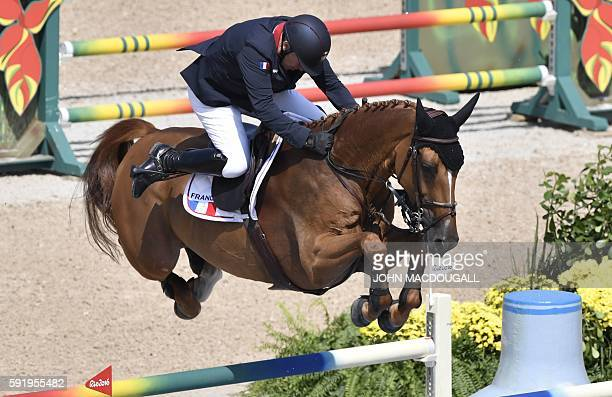 France's Roger-Yves Bost on his horse Sydney Une Prince takes part in the final round of the individual equestrian show jumping event at the Olympic...